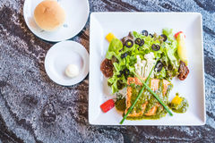 Grilled salmon steak. With salad Stock Photos
