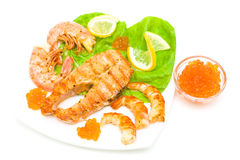 Grilled salmon steak, shrimp and red caviar isolated on white ba Royalty Free Stock Photo