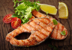 Grilled salmon steak slices Stock Photos