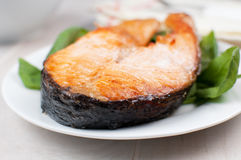Grilled salmon steak on spinach Stock Image