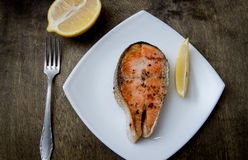 Grilled salmon steak on a square plate. Grilled salmon steak on a square white plate Stock Photography