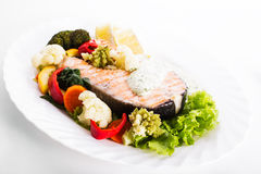 Grilled salmon steak with vegatables Royalty Free Stock Photo