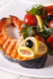 Grilled salmon steak and vegetable salad close up vertical Royalty Free Stock Photography