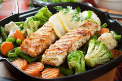 Grilled salmon steak and vegetables Stock Image