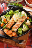 Grilled salmon steak and vegetables Stock Photography