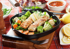 Grilled salmon steak and vegetables. In grilling pan Stock Photos