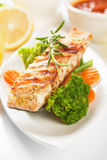 Grilled salmon steak and vegetables Royalty Free Stock Photo