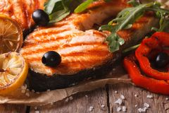 Grilled salmon steak and vegetables Horizontal close-up, rustic Royalty Free Stock Photos