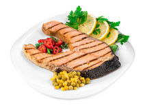 Grilled salmon steak with vegetables. Stock Images