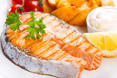 Grilled salmon steak with vegetables Royalty Free Stock Images