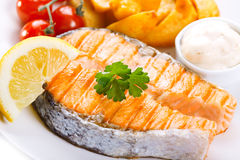 Grilled salmon steak with vegetables Royalty Free Stock Photography