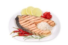 Grilled salmon steak with vegetables on plate. Royalty Free Stock Photos