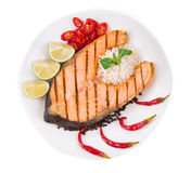 Grilled salmon steak with vegetables on plate. Stock Photography