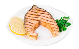 Grilled salmon steak with vegetables on plate. Royalty Free Stock Photo