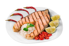 Grilled salmon steak with vegetables on plate. Stock Images