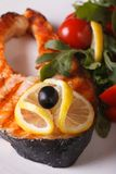 Grilled salmon steak and vegetables on plate macro vertical Stock Images