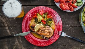 Grilled salmon steak with vegetables on plate tasty and healthy dinner. stock photos