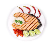 Grilled salmon steak with vegetables Stock Image