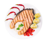 Grilled salmon steak with vegetables on plate. Stock Image
