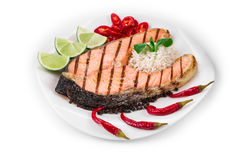 Grilled salmon steak with vegetables on plate. Royalty Free Stock Photography