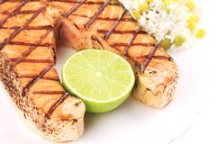 Grilled salmon steak with vegetables on plate. Royalty Free Stock Image