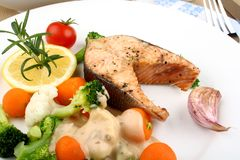 Grilled salmon steak and vegetables with sauce Stock Photos