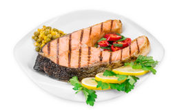 Grilled salmon steak with vegetables. Stock Photography