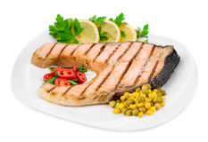 Grilled salmon steak with vegetables. Royalty Free Stock Photos