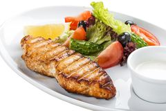 Grilled salmon steak with vegetables. On a white plate stock photo