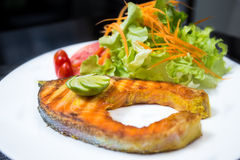 Grilled salmon steak. On white dish Stock Photography