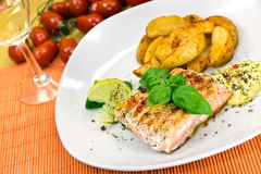 Grilled Salmon Steak With Potato Wedges Stock Images
