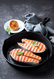 Grilled salmon steaks in cast iron pan Royalty Free Stock Photos