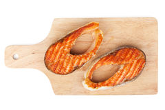 Grilled salmon steaks on cutting board Stock Photo