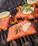 Grilled salmon steaks on fire Royalty Free Stock Image