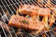 Grilled salmon steaks on the flaming stock photo