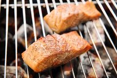 Grilled salmon steaks on the flaming Royalty Free Stock Photo