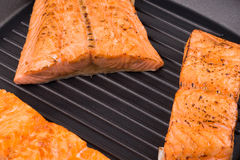 Grilled salmon steaks on frying pan. Stock Image