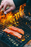 Grilled salmon steaks on a grill. Fire flame grill. Restaurant and garden kitchen. Garden party. Healthy dish. Stock Photography