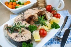 Grilled salmon steaks and vegetables, close up Royalty Free Stock Photo