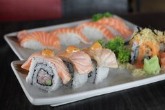 Grilled salmon sushi roll - japanese food. stock photos