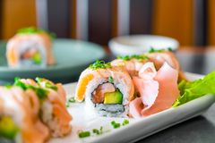 grilled salmon sushi roll stock photography