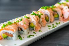 grilled salmon sushi roll stock image