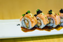 Grilled salmon sushi roll royalty free stock image