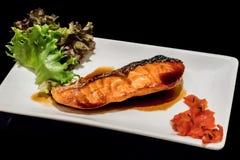 Grilled salmon with teriyaki sauce stock image