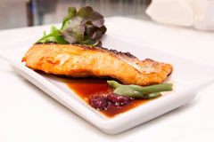 Grilled salmon with teriyaki sauce. On the table Royalty Free Stock Photos