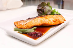 Grilled salmon with teriyaki sauce. On the table Stock Photos
