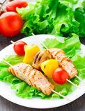 Grilled salmon and vegetable skewers Stock Photography