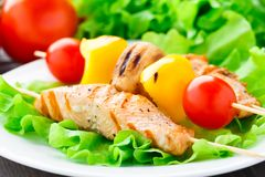 Grilled salmon and vegetable skewers Royalty Free Stock Photo