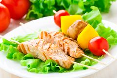 Grilled salmon and vegetable skewers Royalty Free Stock Image