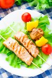 Grilled salmon and vegetable skewers Royalty Free Stock Images